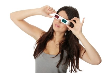 Photo of a woman wearing 3D glasses